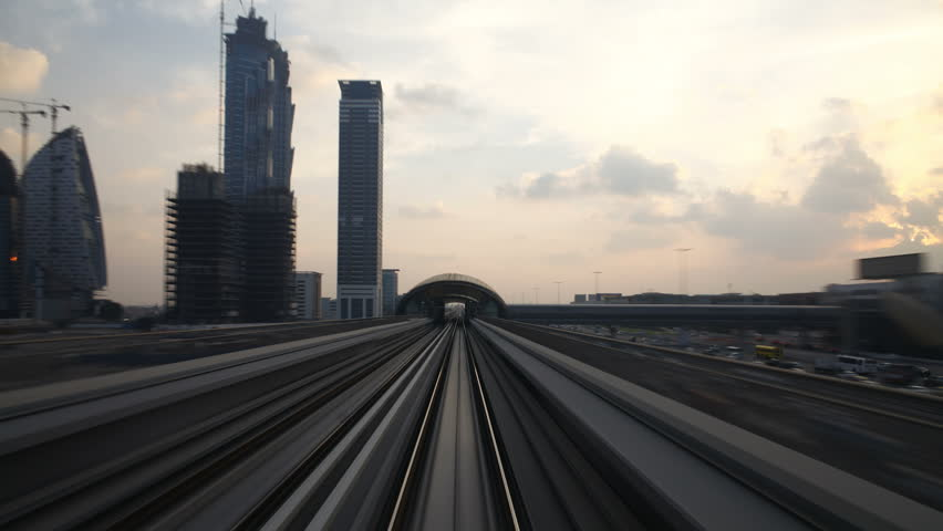 DUBAI, UNITED ARAB EMIRATES - CIRCA MAY 2011: a view of Dubai elevated Rail Metro System, running alongside the Sheikh Zayed Rd.