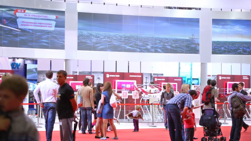 MOSCOW - MAY 21: Visitors walk on exhibition of helicopter industry of Helirussia in Exhibition center Expo Crocus, on May 21, 2012 in Moscow, Russia
