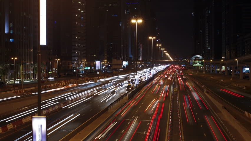 DUBAI, UNITED ARAB EMIRATES - CIRCA MAY 2011: Sheikh Zayed Rd, traffic and new high rise buildings along Dubai's main road at night
