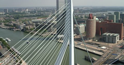 Aerial of the Erasmus Bridge in Rotterdam with some buildings on the background, Rotterdam, Netherlands.