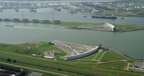 Aerial view of Rotterdam Harbor above Maeslantkering this is a storm surge barrier on Nieuwe Waterweg and Europort. Shot on a RED Dragon.