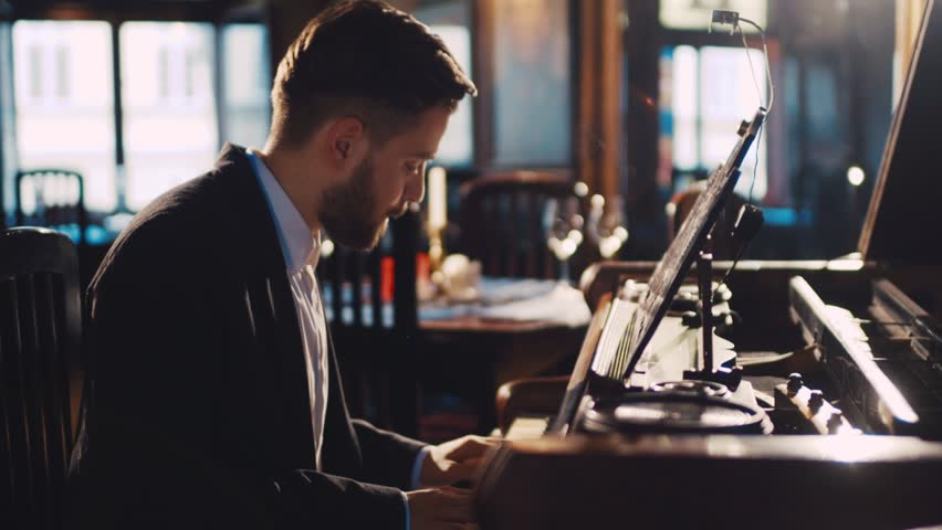 Close up view of an old-fashioned bearded pianist playing the fortepiano in a deserted restaurant. Enjoying the music, jazz. Elegant outfit. Romantic atmosphere. | Shutterstock HD Video #26006762