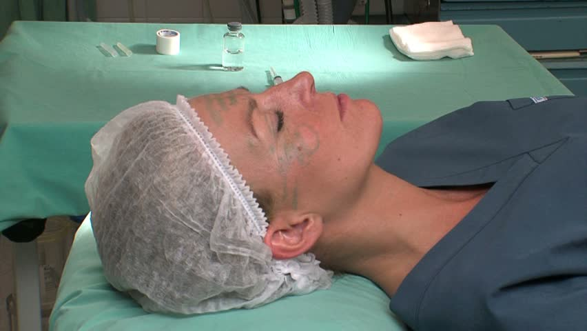 Botox injection into patient's face
