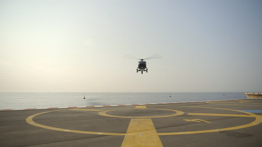 Front view of Helicopter landing at Monaco Heliport with ocean in the background