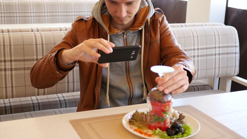 Food Photo Man Take Pictures Of Vegetables Salad Via Mobile Smartphone in restaurant | Shutterstock HD Video #26138852