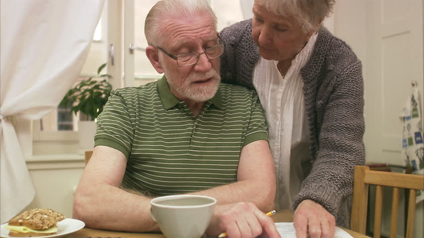 An elderly couple at home