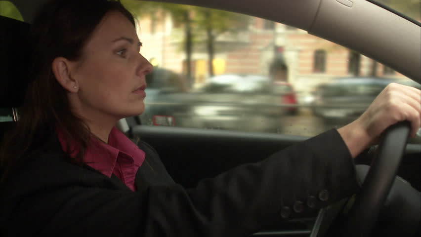 A woman driving a car | Shutterstock HD Video #2615912