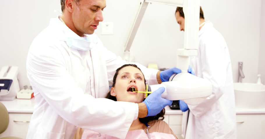 Dentist taking x-ray of patients teeth at dental clinic | Shutterstock HD Video #26163965