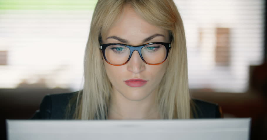 Serious young woman using computer late at work. | Shutterstock HD Video #26179382
