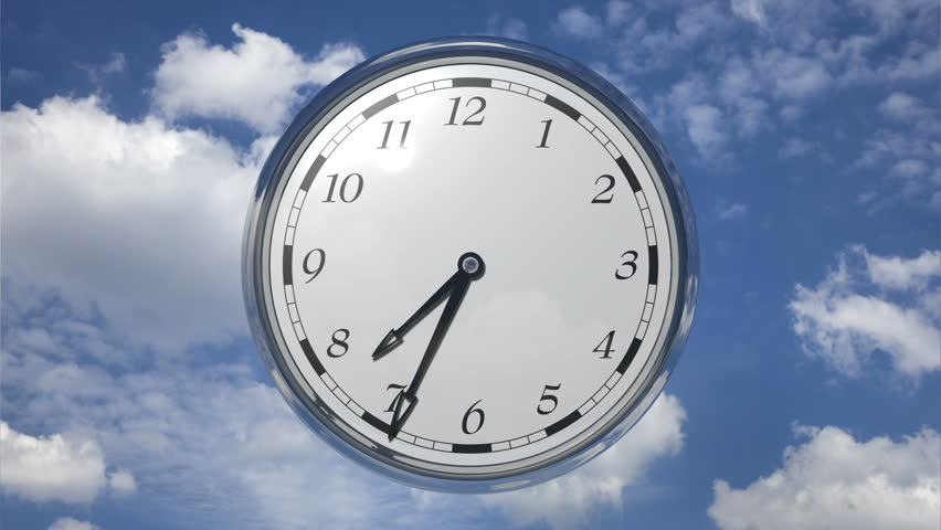 Time lapse Time runs fast, clock running twelve hours on sky background with clouds.