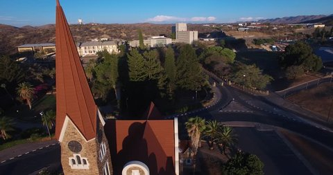 Aerial drone video with view of old historical fort in city center of Windhoek, other old buildings and church in town in central highland Khomas Hochland of Namibia, southern Africa