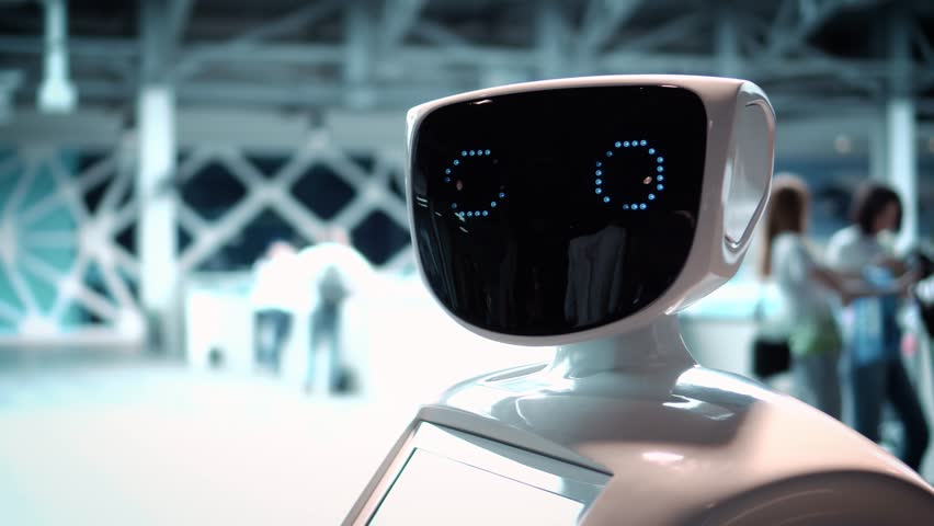 Modern Robotic Technologies. The robot looks at the camera at the person. The robot shows emotions. Raises his hands up, dances or is indignant. Or attacks #26223152