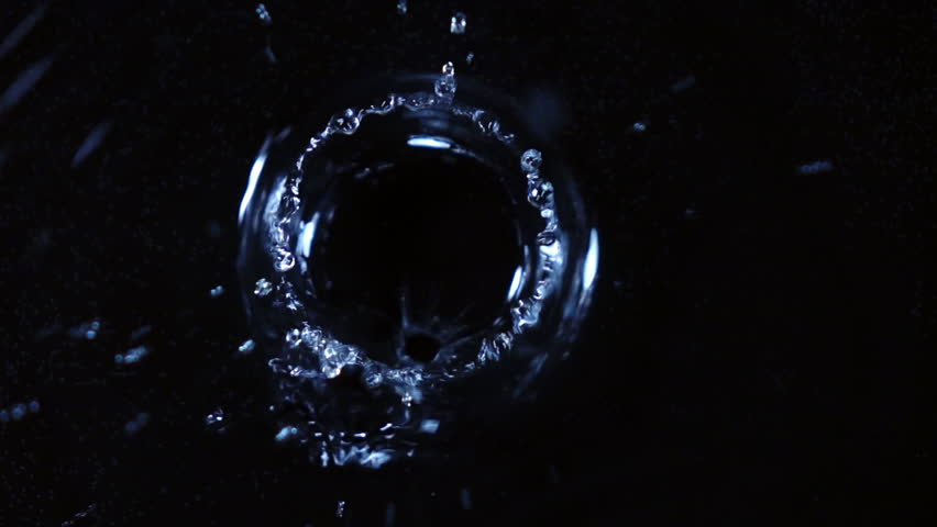 Water drops are falling and making ripple. Closeup top view. Shooing with high speed camera. Extreme slow motion. | Shutterstock HD Video #26246822