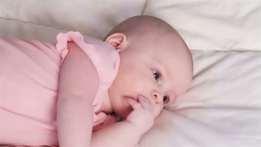 hd00 30Adorable Baby Girl On Blanket Teething and Chewing her ... aea42328508c