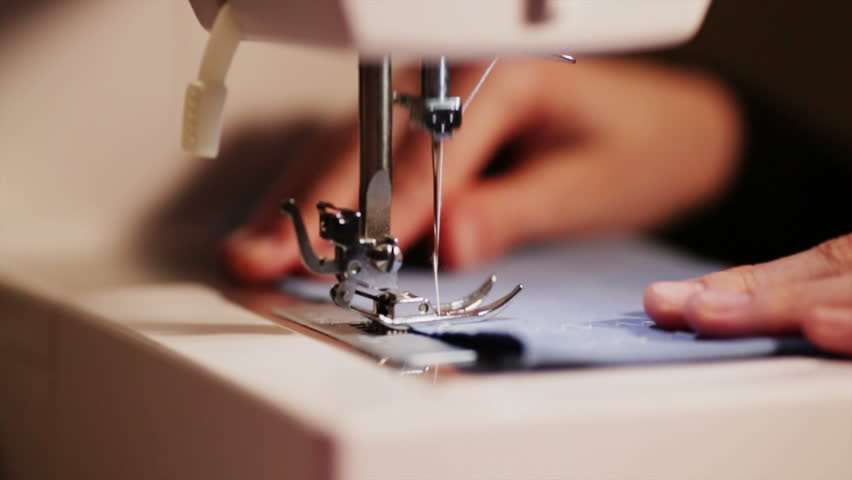 Girl sews clothes on a sewing machine blue and yellow close-up sewing needles | Shutterstock HD Video #26274182