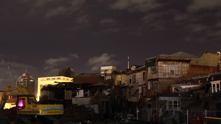 Time lapse of clouds moving over collapsed buildings from the Christchurch earthquake   Shutterstock HD Video #2627507