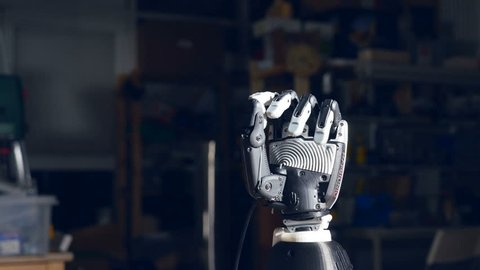 Close up. Prosess of the futuristic robot hand's closing.