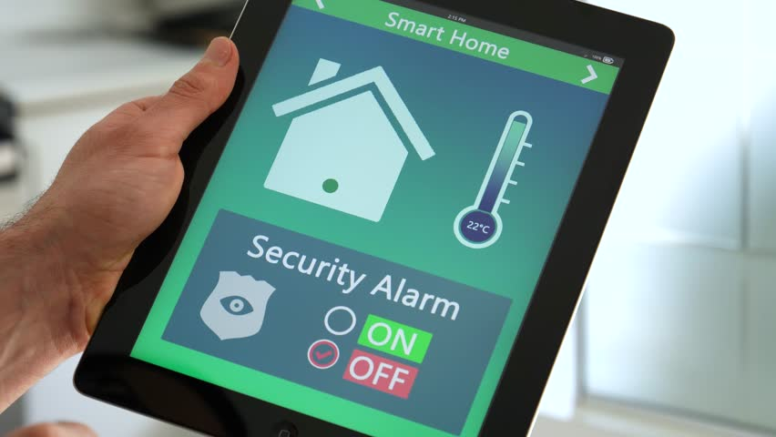 Controlling the security alarm of the house on a smart home tablet app.