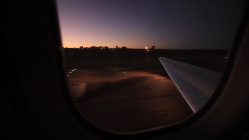 POV through window of a plane taking off from an African airport. The runway is not smooth, so the takeoff is really jerky.