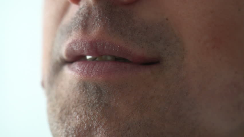 Man Biting and Licking Lips Close up | Shutterstock HD Video #26338322