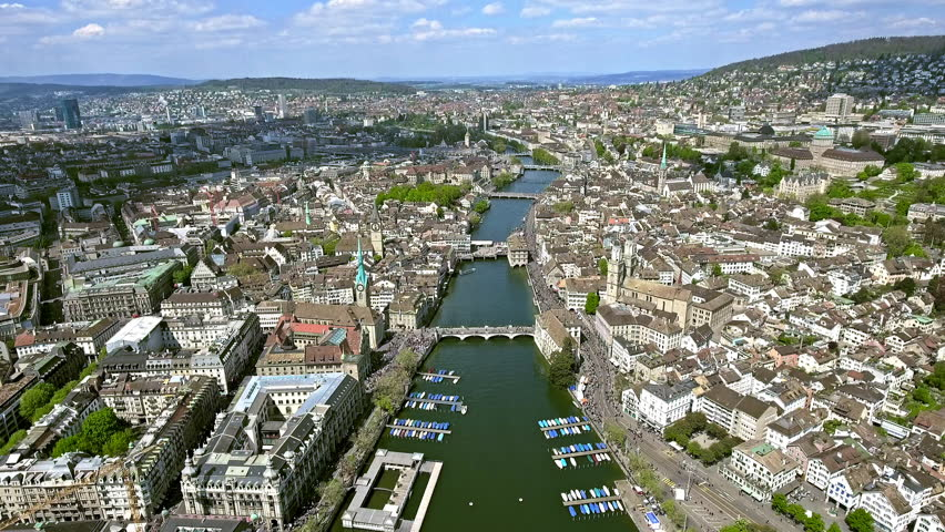 Flying over the City of Zurich in Switzerland Aerial Shot in 4K Ultra HD feat. Limmat River, Bridges and Famous Landmarks | Shutterstock HD Video #26379092