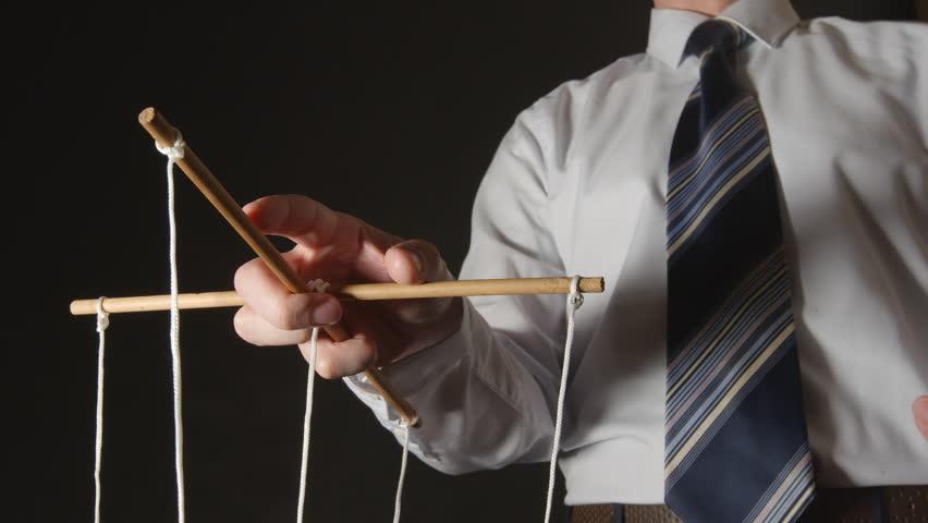 MANIPULATION: Businessman in a shirt manipulating