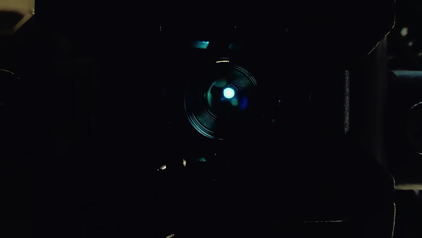 Operation of the laser head when trying to read information from the disk. Close-up. Macro.