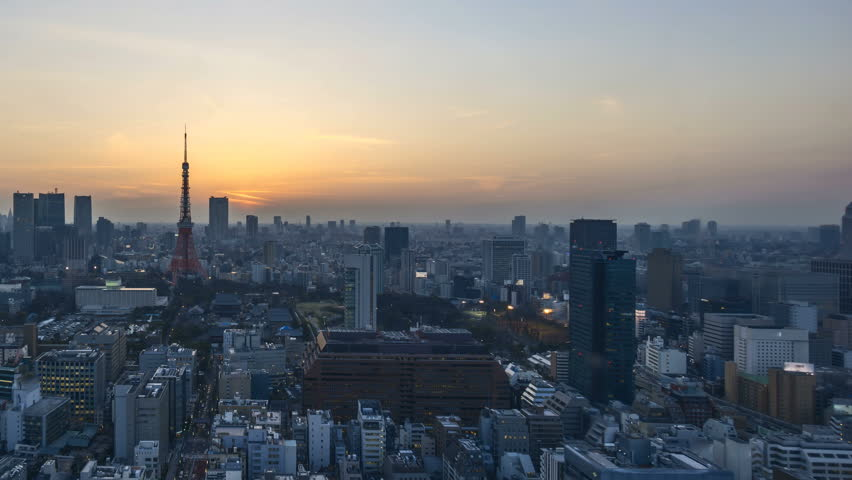 4k time lapse of night to day sunrise scene at Tokyo city skyline with Tokyo Tower. pan left | Shutterstock HD Video #26419385
