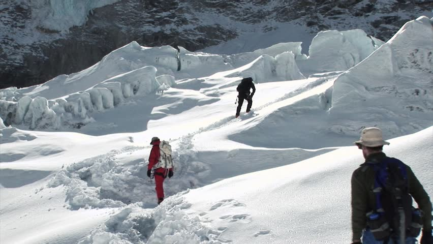 Hikers and sherpas climb/trek their way to the summit of Mount Everest, Himalayas, Nepal.   | Shutterstock HD Video #26429402