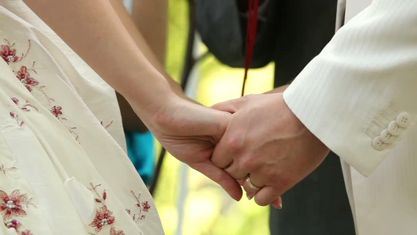 Bride And Fiance Holding Hands During The Wedding Ceremony Hd Stock