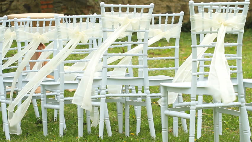 Wedding White Chairs Decorated With Ribbons