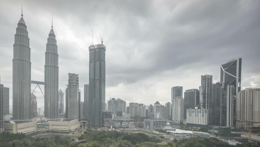 4k time lapse. Kuala Lumpur city urban skyline against cloudy sky followed by shower rain thunderstorm and rain drops behind a glass wall. Pan left   Shutterstock HD Video #26478884