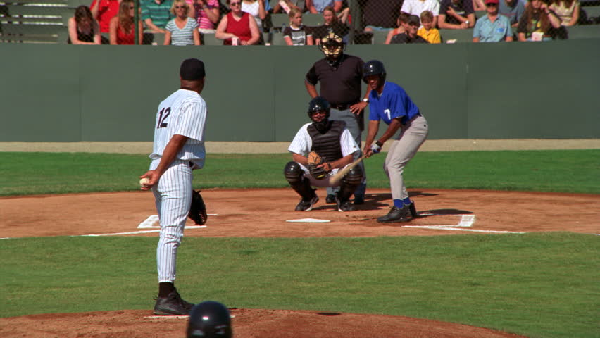 Pitcher pitching a walk at a ball game