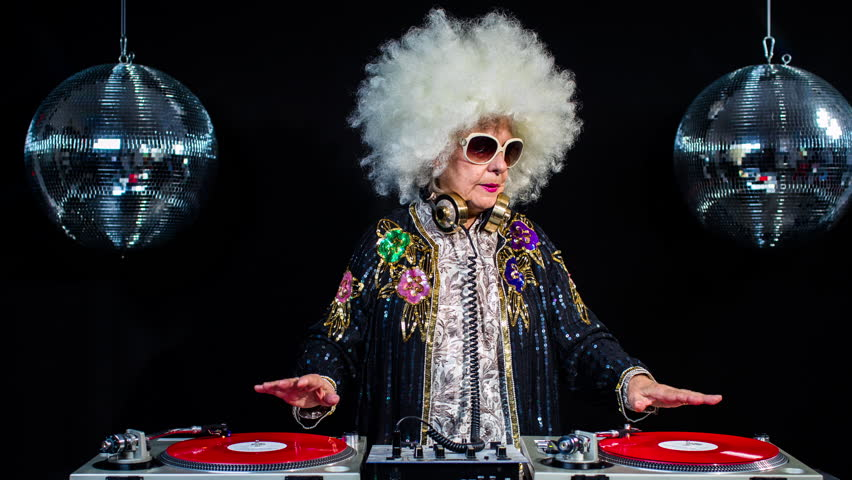 amazing DJ grandma, older woman djing and partying in a disco setting. these retired rockers will get the party going