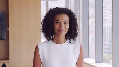 Portrait Of Businesswoman In Office Walking Towards Camera