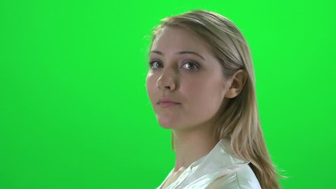side profile face view of young attractive blond caucasian women isolated against green screen background
