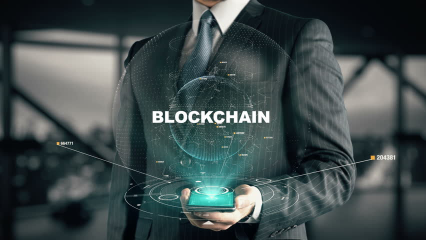 Businessman with Blockchain hologram concept