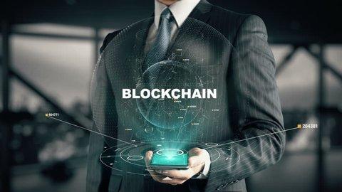Businessman with Blockchain hologram concept