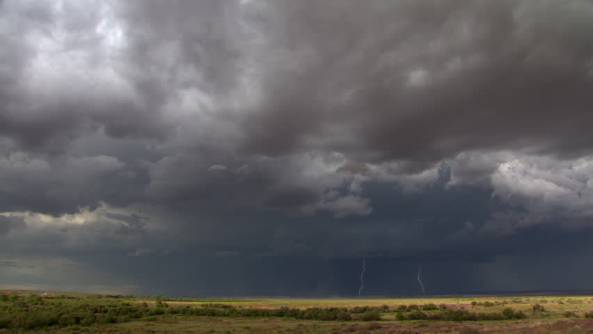 Time-lapse clouds and lightning over prairie horizon