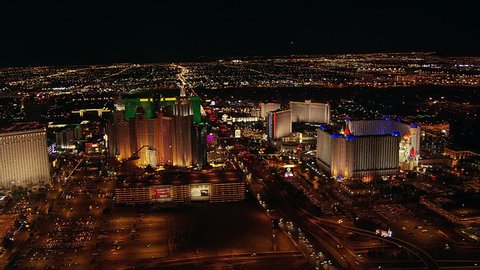High flight over Flamingo Avenue and Las Vegas casinos at night. Shot in 2005.
