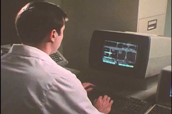 1980s: A mass spectrometer is utilized and results are reviewed, during a Urinalysis Inspection Testing Program procedure, at Brooks Air Force Base, in San Antonio, Texas, in 1985.