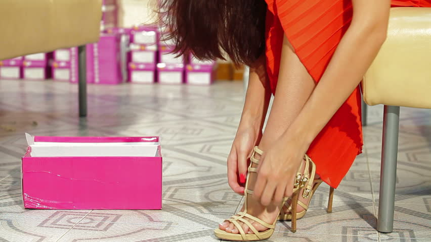 Young Woman Trying On High Heels In Shoe Store Stock Footage Video ...