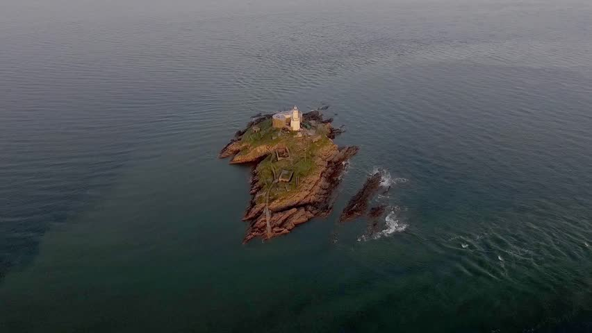 Drone view of the iconic the Mumbles lighthouse structure in Swansea Bay, Gower, South Wales, UK