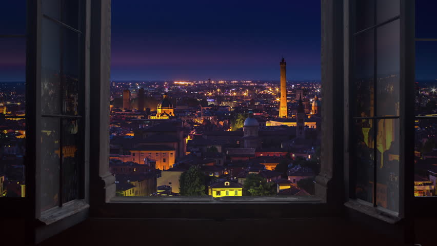 bologna skyline timelapse from night to day seen through window