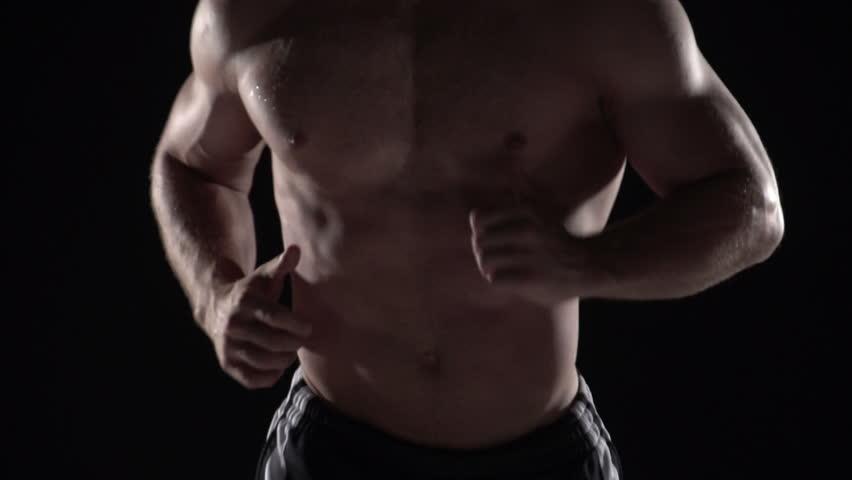 Muscular man running towards camera, torso shot center #2667536
