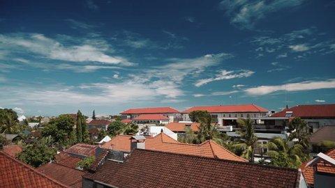 Bali Seminyak orange tile roofs and blue sky