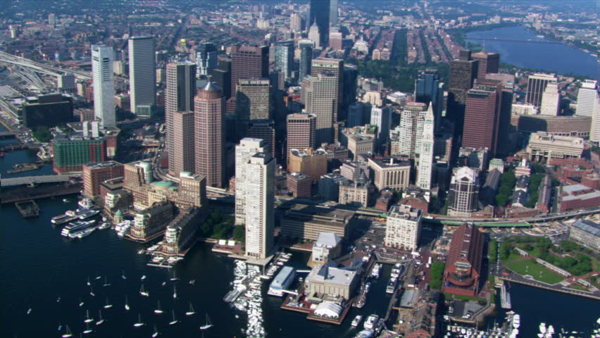 Flight over Boston Harbor with cityscape view. Shot in 2003.