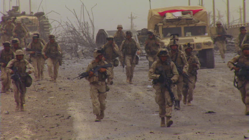 Marines advancing toward Baghdad, accompanied by armored vehicles