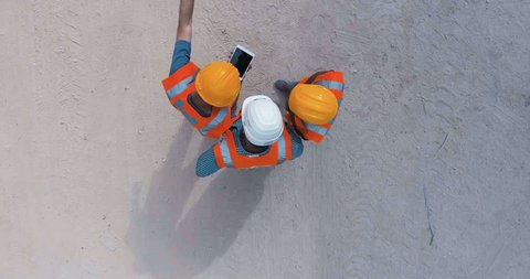 Aerial shot of  construction workers on a large highway construction site