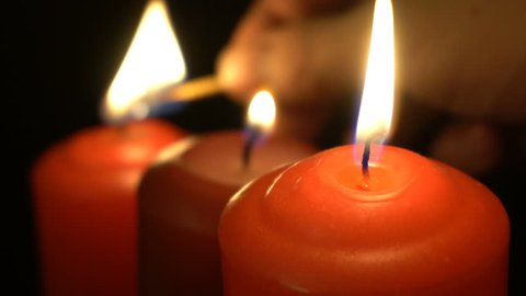 igniting fire candles on a black background